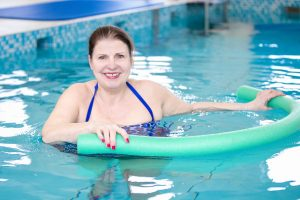 member in the pool during hydrotherapy