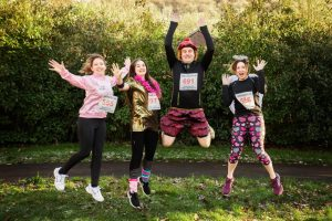 Fun runners jumping in joy