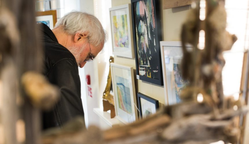 Visitor looking at art at the pop up art weekend