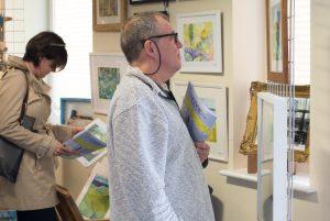 Man admiring art at the pop up art weekend