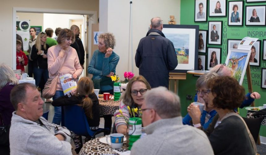 People enjoying refreshments in the atrium