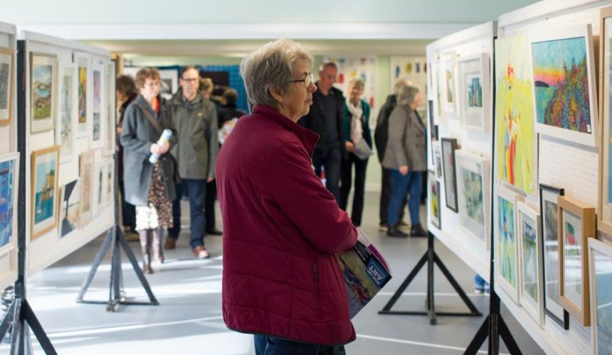 Woman admiring art at the pop up art weekend