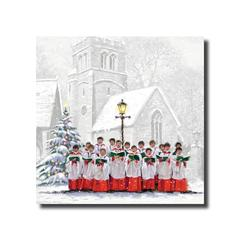 A choir in formal red and white dress singing in front of a snow-covered church