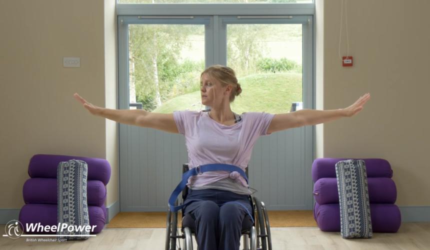 a woman doing yoga in a wheelchair