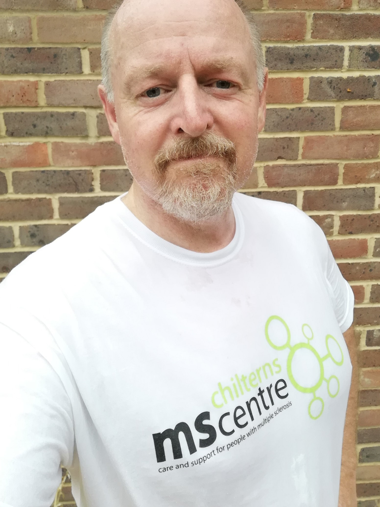 man wearing a chilterns ms centre tshirt