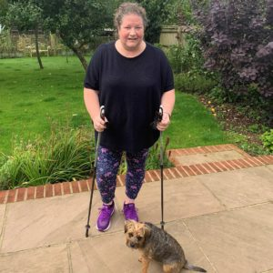 sarah with her dog and nordic walking sticks