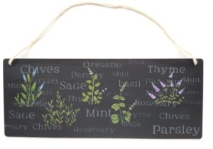 Hand painted herbs pictures and words on black wall hanging.